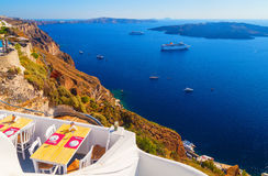 View in Fira on cafe overlooking the Caldera and cruise ship at sea. Santorini, Greece Royalty Free Stock Images
