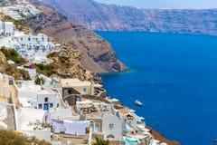 View of Fira town - Santorini island,Crete,Greece.. View of Fira town - Santorini island,Crete,Greece. White concrete staircases leading down to beautiful bay Stock Photos