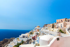 View of Fira town - Santorini island,Crete,Greece.. White concrete staircases leading down to beautiful bay with clear blue sky and sea Stock Image