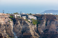 View of Fira town - Santorini island,Crete,Greece. Beautiful bay with clear blue sky and sea Stock Photos