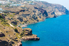 View of Fira town - Santorini island,Crete,Greece. White concrete staircases. Leading down to beautiful bay with clear blue sky and sea Royalty Free Stock Photo
