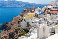 View of Fira town - Santorini island,Crete,Greece. White concrete staircases leading down Stock Images