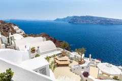View of Fira town - Santorini island,Crete,Greece. White concrete staircases leading down to beautiful bay. With clear blue sky and sea Royalty Free Stock Photo