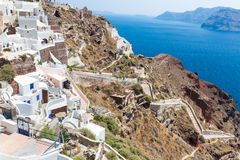 View of Fira town - Santorini island,Crete,Greece. White concrete staircases leading down to beautiful bay Royalty Free Stock Photo