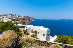 View of Fira town - Santorini island,Crete,Greece. White concrete staircases leading down to beautiful bay Royalty Free Stock Image