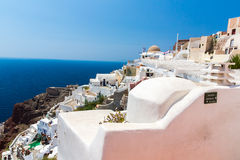 View of Fira town - Santorini island,Crete,Greece. White concrete staircases leading down to beautiful bay Stock Photo