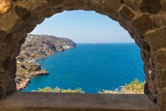 View of Fira town - Santorini island,Crete,Greece. White concrete staircases leading down to beautiful bay. With clear blue sky and sea Stock Image