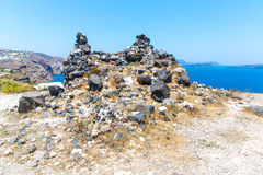 View of Fira town - Santorini island,Crete,Greece. White concrete staircases leading down to beautiful bay with clear blue sky. And sea Royalty Free Stock Photography