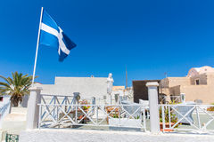 View of Fira town - Santorini island,Crete,Greece. White concrete staircases leading down to beautiful bay Stock Image
