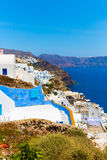 View of Fira town - Santorini island,Crete,Greece. White concrete staircases leading down to beautiful bay Stock Photography