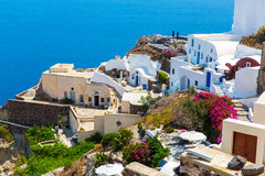 View of Fira town - Santorini island,Crete,Greece. White concrete staircases leading down to beautiful bay. With clear blue sky and sea Royalty Free Stock Images