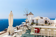 View of Fira town - Santorini island,Crete,Greece. White concrete staircases leading down to beautiful bay with clear blue sky and sea Stock Image