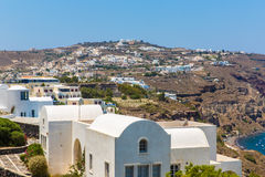 View of Fira town - Santorini island, Crete, Greece. View of Fira town - Santorini island,Crete,Greece. White concrete staircases leading down to beautiful bay Stock Photos