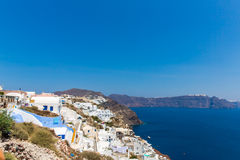 View of Fira town - Santorini island,Crete,Greece. White concrete staircases leading down to beautiful bay. With clear blue sky and sea Stock Photos