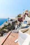 View of Fira town - Santorini island,Crete,Greece. White concrete staircases leading down to beautiful bay Royalty Free Stock Images