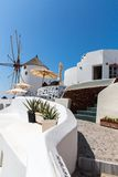 View of Fira town - Santorini island,Crete,Greece. White concrete staircases leading down to beautiful bay with clear blue sky and sea Royalty Free Stock Photography