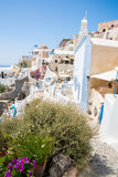 View of Fira town - Santorini island,Crete,Greece. White concrete staircases leading down to beautiful bay with clear blue sky Stock Photography