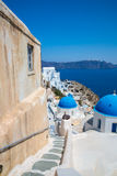 View of Fira town - Santorini island,Crete,Greece. White concrete staircases leading down to beautiful bay with clear blue sky Stock Photos