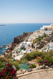 View of Fira town - Santorini island,Crete,Greece. White concrete staircases leading down to beautiful bay with clear blue sky and Royalty Free Stock Images