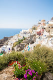 View of Fira town - Santorini island,Crete,Greece. White concrete staircases leading down to beautiful bay with clear blue sky and Royalty Free Stock Image