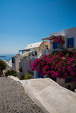 View of Fira town - Santorini island,Crete,Greece. White concrete staircases leading down to beautiful bay with clear blue sky and Stock Photos