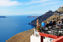 The view on Fira town and tourists enjoying their vacation Stock Photography