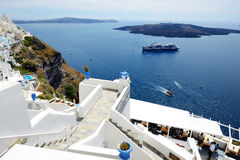 The view on Fira town and tourists enjoying their vacation Stock Photo