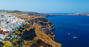 View of Fira village built on top of volcano cliff and blue sea Santorini island, Greece Royalty Free Stock Photos