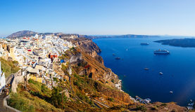 View of Fira village built on top of volcano cliff and blue sea Santorini island, Greece, Europe. View of Fira village built on top of volcano cliff and blue sea Stock Image