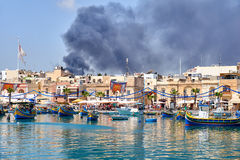 The view of fire accident in the Marsaxlokk fishing village, Mal Royalty Free Stock Image