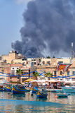 The view of fire accident in the Marsaxlokk fishing village, Mal Royalty Free Stock Photos