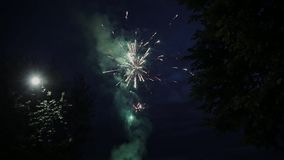 View of fireworks and salute from a clearing located in the French Alps in Courchevel. Fire show. Night. Colored lights stock video footage