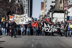 View of the First line of Protesters walking in the Street royalty free stock photo