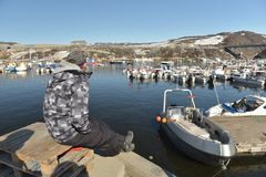 View of the fishermans ships on harbour in Greenland Stock Photo