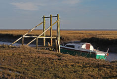A view of fishing boat on Thornham Marsh, North Norfolk. Stock Photo