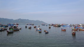 View of fishing boats anchorage in bay by village at dawn. Panorama of vietnamese fishing boats anchorage in sea bay near fishing village at dawn stock video