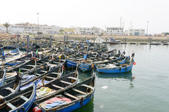 View of fishing boats in Essaouira port Stock Photos