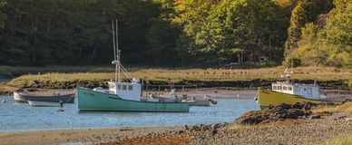 Maine Fishing Boats at Low Tide. A view of fishing boats In the harbor at Kennebunkport, Maine at low tide royalty free stock photos