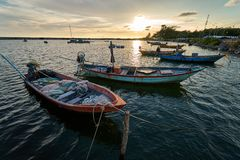 View of the fishing harbor Sunset Latinos There is a boat landing. In a fishing village in Rayong, Thailand, fishing is the main stock photography