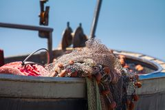 A view of a fishing net inside of the boat in the sea. Beautiful calm sea and water during an hot summer day stock photo