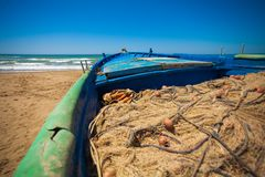 A view of a fishing net inside of the boat in the sea. Beautiful calm sea and water during an hot summer day stock photos