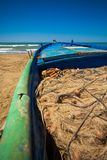 A view of a fishing net inside of the boat in the sea. Beautiful calm sea and water during an hot summer day royalty free stock photos