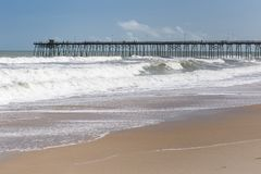Fishing Pier at Kure Beach, NC royalty free stock photo