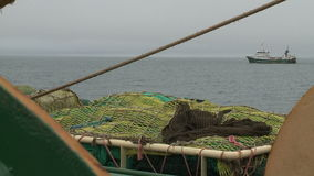 View from the fishing trawler on other ships stock video
