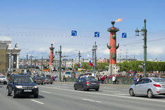 View on the flaming Rostral columns from the Palace bridge. Saint Petersburg Stock Photo