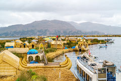 View at the Floating Island Los Uros with typical boats Stock Photo