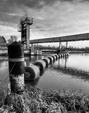 View of a flood defence and flotation system seen in a river inlet. royalty free stock image