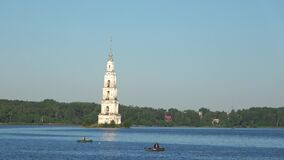 View of the flooded bell tower of St. Nicholas Cathedral on a Sunny July morning. Kalyazin, Russia. View of the flooded bell tower of St. Nicholas Cathedral on a stock video