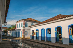 View of flooded cobblestone street with old houses at the sunset in Paraty. Royalty Free Stock Images