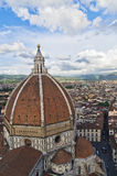 View of Florence with a dome of Santa Maria del Fiore cathedral in front Royalty Free Stock Photos